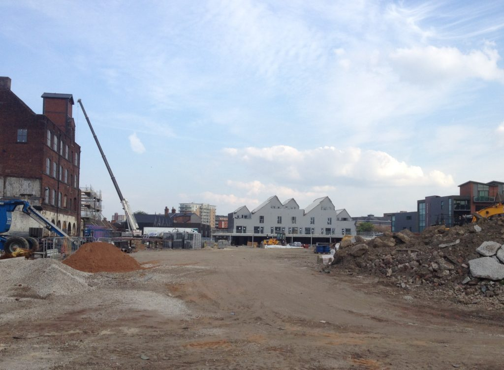 As taken from Green Lane end, phase 1b is visible in the distance with the pitched roofs.
